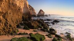 Algarve, rocky beach near Lagos, sunrise time, Portugal Stock Footage