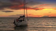Sunset scenery with sailing boat Stock Footage