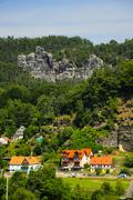 Stock Photo of Germany, Saxony, Rathen, Houses and Elbe Sandstone Mountains
