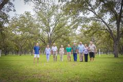 USA, Texas, Group  of senior citizens in park - stock photo