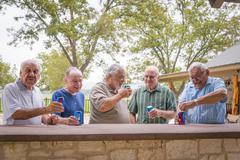 USA, Texas, Senior men standing at bar, drinking beer - stock photo