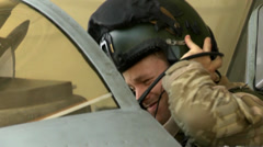 Fighter Pilot puts on his helmet Stock Footage