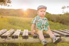 USA, Texas, Baby boy sitting on jetty Stock Photos