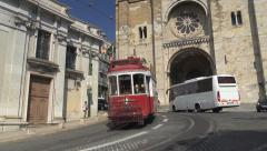 Tram 28, Lisbon, line tram and Sé Cathedral, Alfama district, Lisbon, Portugal Stock Footage