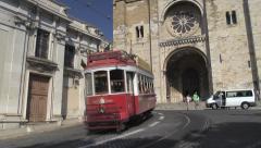 Tram 28, Lisbon, line tram and Sé Cathedral, Alfama district, Lisbon, Portugal Stock Footage
