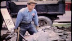 623 - hard work, man loads wheelbarrow  - vintage film home movie - stock footage