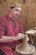 Potter, creating an earthen jar on the circle, andalusia, spain Stock Photos