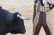 Stock Photo of bullfighter very close to the bull, andalucia, spain