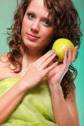 Stock Photo of beautiful spring woman with apple. green concept