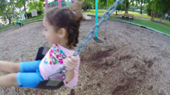 A child on a park swing Stock Footage