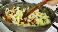 Stock Video Footage of Chief stirring ingredients of pilaf in kettle