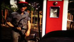 639 - gas station attendant smiles at camera - vintage film home movie Stock Footage
