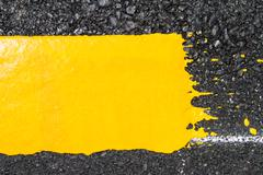 Yellow line on road texture Stock Photos