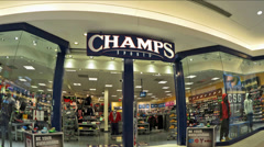 Champs Sports mall storefront - zoom out Stock Footage