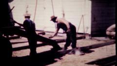 622 - cement mixer pours concrete at construction site  -vintage film home movie Stock Footage