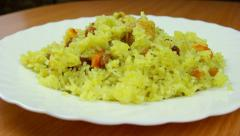 Fresh and hot pilaf in plate, dolly shot Stock Footage