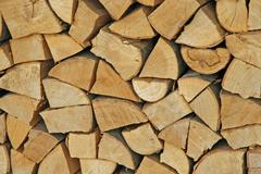 woodpile in the woodshed ready to burn and heat - stock photo