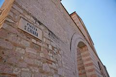 basilica of santa chiara with the characteristic masonry arches - stock photo