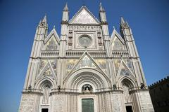 shining facade of the duomo of orvieto - stock photo