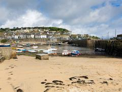 English fishing village Mousehole harbour Cornwall England - stock photo