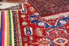 collection of valuable carpets of afghan origin - stock photo