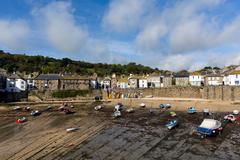 Mousehole harbour Cornwall England UK Cornish fishing village - stock photo