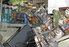 Electronic equipment and circuit boards disposed in waste landfill Stock Photos