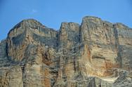 Stock Photo of rocky wall with orange nuances of the dolomites