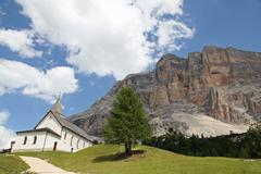 little church in the foothills of the dolomites - stock photo
