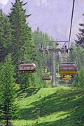 chair lift up to the top of the mountain - stock photo