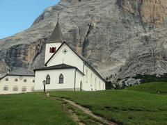 convent and church of the friars in the foothills of the dolomites - stock photo