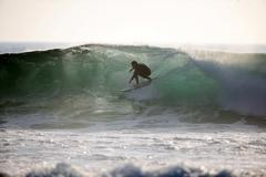 Surfer in a green room Stock Photos