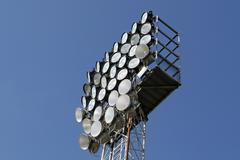 Towers with spotlights and floodlights to illuminate the games at the stadium Stock Photos