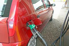 car makes a supply of green unleaded fuel distributor - stock photo
