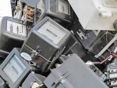Counters electricity demolished in a landfill for industrial waste Stock Photos