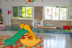 Interior of a playroom a nursery kindergarten school Stock Photos