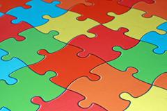 Colored pieces of a complicated puzzle Stock Photos