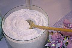 Purple lavender scented powder on sale with a spoon Stock Photos