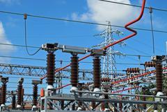 powerhouse with lattice girders, disconnectors, bars of copper - stock photo
