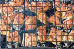 Juicy slices of meat with sauce prepare on fire Stock Photos
