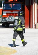 Fireman with oxygen tank during an exercise in the barracks Stock Photos