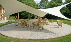 awning to shade the chairs of the guests during a reception - stock photo