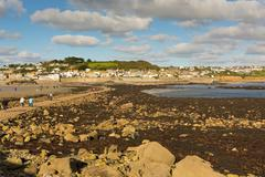 View from St Michaels Mount to Marazion Cornwall with people crossing Stock Photos