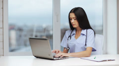 Doctor or nurse with laptop pc writing prescription Stock Footage