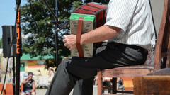 Senior man plays with small accordion with  foot hitting throb Stock Footage