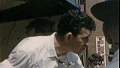Salesman WORKS CROWD Hawker Customers 1960s Vintage Film Home Movie 7328 Stock Footage