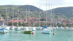 Sailing boats docked in the port Stock Footage