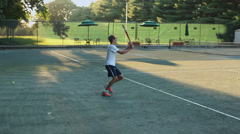 Two people playing tennis Stock Footage