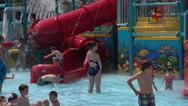 Stock Video Footage of Sprinkler Fun at Community Pool (2 of 2)