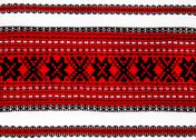 Stock Photo of ukrainian traditional red and black ornament embroidery closeup